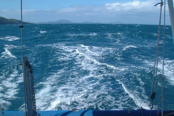 Our foaming wake as we screamed into Airlie Beach