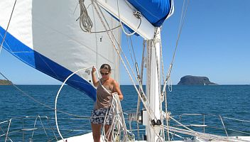 Amanda coiling the halyard as we leave Mitsio