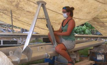 Amanda polishing the forebeam A-frame