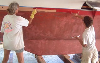 Sue and Chris paint the starboard hull