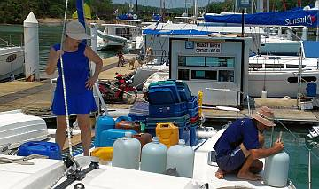 Gail helps Jon siphon water into our starboard tank