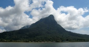 Santubong Peak over the river and village, outside Kuching, Malaysia