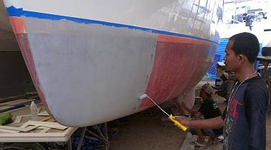 Painting primer on the port hull to finish the priming job