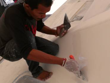 Baw, our Master Artist, touching up parts of the foredeck