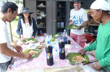 Golf, Mai, Jon & Houa having lunch at our makeshift picnic table