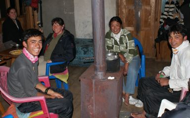 Amanda, Sonia, & our porters around the lodge fireplace