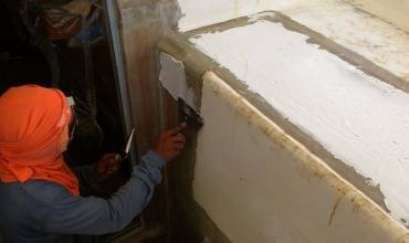 Chai putting several layers of filler around the companionway