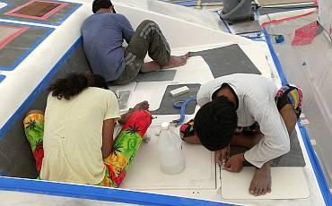 Chandron, Pla & Yando cleaning & preparing the foredeck