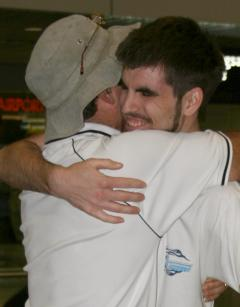 Bear hugs for Chris at the KL airport