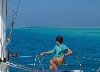 Chris riding the bow as we dodge reefs in Los Roques