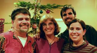 Our family in front of our wild Christmas tree