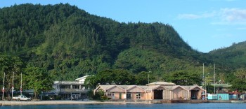 The waterfront of Huahine shows its one street of docks and businesses.