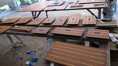 Our many floorboards, bottoms epoxied & ready for polyurethane