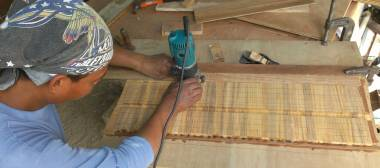 Houa cutting slots in the teak strips for the lattice with his router