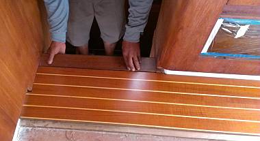 The top of the starboard step needs a small strip of teak added