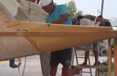 Houa working on the port-side transom extension