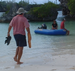 Jon wading out to Scud's dinghy with the daily baquette.