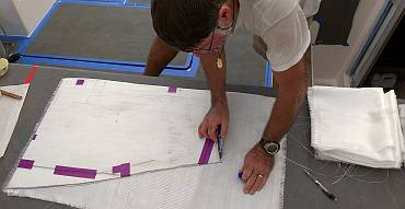 Using a template to cut out 200g glass cloth for the rudder
