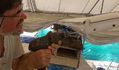 De-coring the port side of the bimini, where the leg bolts will go