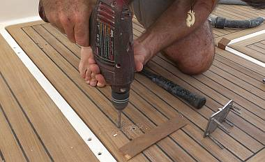 Drilling the hinge mounting holes through Houa's beautiful teak
