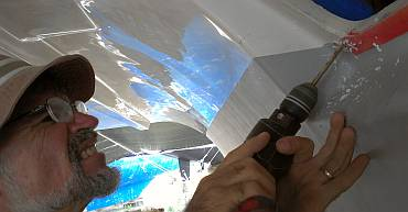 Drilling mounting holes for the emergency hatch polycarbonate
