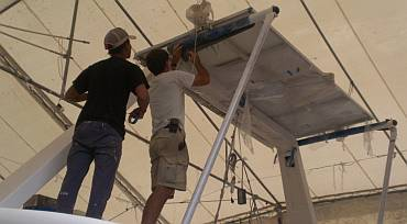 Moving the solar panels from the targa-bar aft to the davits