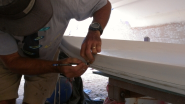 Jon marking where the cuts must go on the sides of the bimini