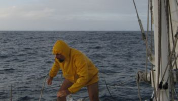 Jon returns from reefing the mainsail in a squall