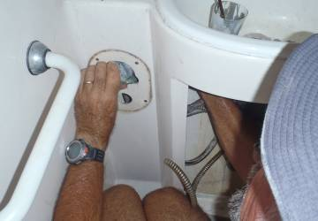 Jon removing water-control valves from the bathrooms