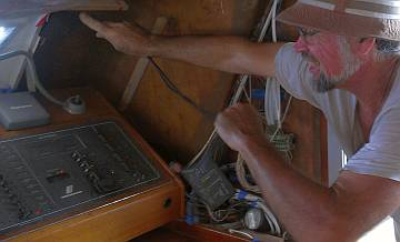 Jon pulling transducer wires to the nav-station