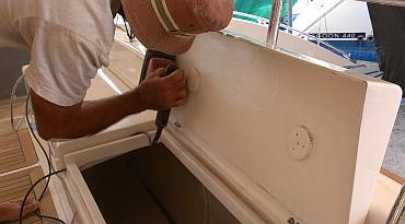 Sanding the edges of the lockers under the aft cockpit seats