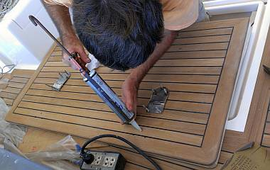 Installing the big hinges on the big starboard cockpit hatch