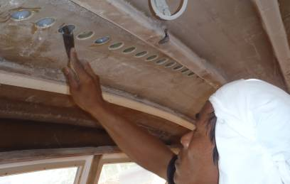 Kao filling decoring holes for the sail-track in the salon ceiling
