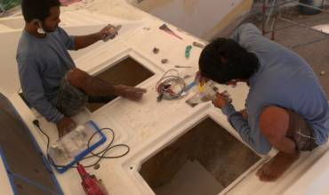 Kwan and Bank working on the forward chain locker hatches