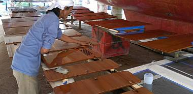 Lek sanding the cabinet doors, preparing them for more varnish
