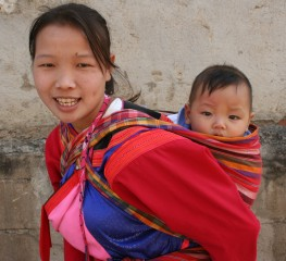 A Lisu Hilltribe girl and baby