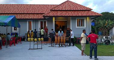 The band setting up in front of Manoon's new house