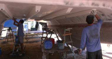 Nut and Pla doing difficult sanding under the bridge-deck