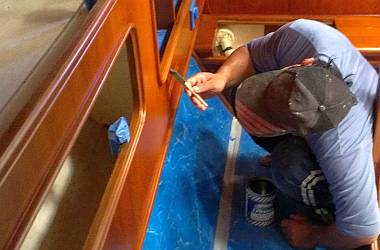 Pla touching up the satin varnish in the port aft cabin