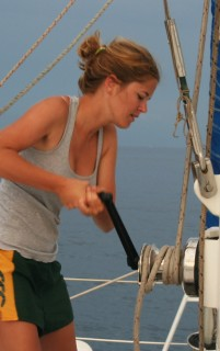 Rachel winching up the mainsail