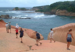 Walking on the clay-like Red Rocks on Dominica's windward side