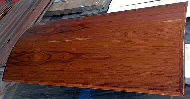 The 2 flaws, where the teak veneer was sanded through