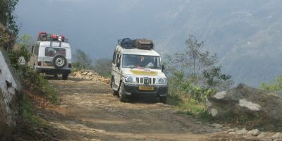 Share jeeps pass on a road in Sikkim