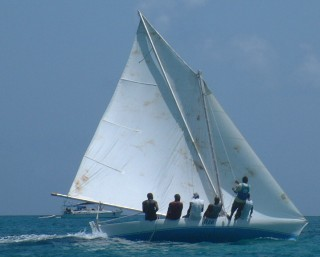 A small sloop racing in the Carriacou Regatta