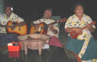 The Bekana band, with their kava bowl in front