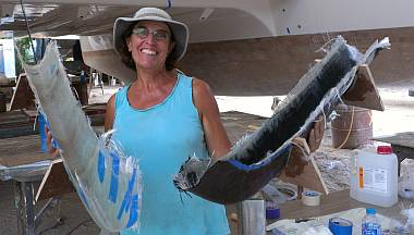 Sue holds the 2 bow molds, port with carbon, starboard without