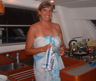 Sue doing dishes in her compact galley
