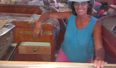 The happy cook in her newly rebuilt galley - new drawer open