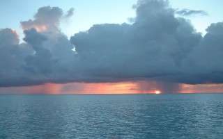 Sunset with a squall and Trade Wind clouds, off Raiatea.