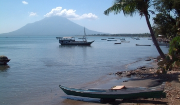 Typical village waterfront with volcano